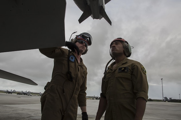 U.S. Marine Corps Sgt. Christopher Edwards, left, and U.S. Marine Corps Cpl. Angel Osoria, aviation ordnance Marines with Marine All Weather Fighter Attack Squadron (VMFA) 225, inspect an F/A-18D Hornet during exercise Cope North 17 at Andersen Air Force Base, Guam, Feb. 3, 2017. The Marines inspect the aircraft prior to take off to ensure it is fit for flight. Marines trained with the Royal Australian Air Force and Japan Air Self-Defense Force supporting theater security, focusing on dissimilar air combat training and large force employment. (U.S. Marine Corps photo by Cpl. Nathan Wicks)