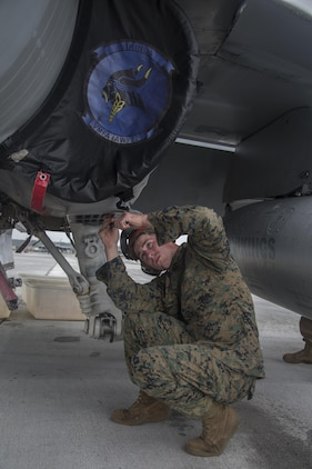 A U.S. Marine with Marine All Weather Fighter Attack Squadron (VMFA) 225 inspects an F/A-18D Hornet during exercise Cope North at Andersen Air Force Base, Guam, Feb. 3, 2017. The Marines inspect the aircraft prior to take off to ensure it is fit for flight. Marines trained with the Royal Australian Air Force and Japan Air Self-Defense Force supporting theater security, focusing on dissimilar air combat training and large force employment. (U.S. Marine Corps photo by Cpl. Nathan Wicks)