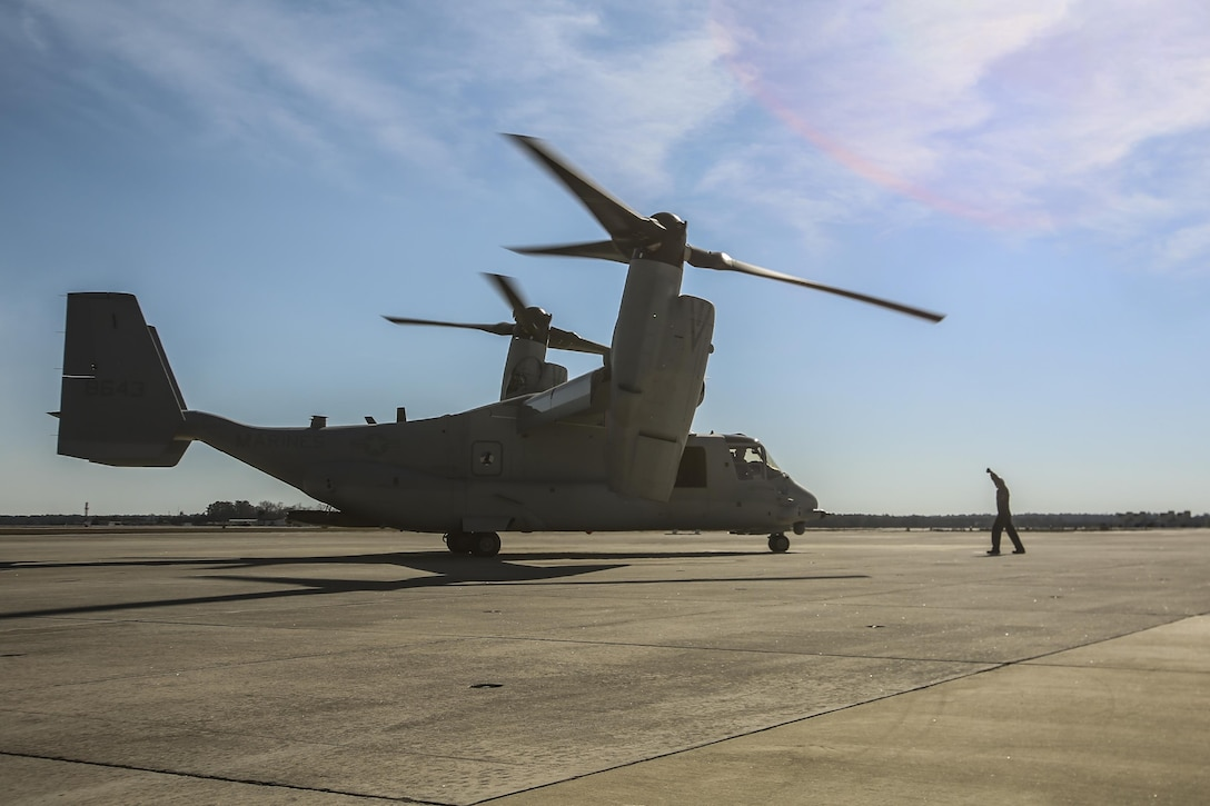 MARINE CORPS AIR STATION NEW RIVER, N.C.—Lance Cpl. Luke Peters directs an MV-22B Block C Osprey after it landed aboard MCAS New River, N.C., Feb. 1, 2017. This is the first time the training squadron has received a brand-new, straight from the factory aircraft. The MV-22B Block C incorporates weather radar; an improved environmental control system; troop commander situational awareness display; upgraded standby flight instrument and GPS; and additional chaff/flare equipment. Block C development first began in 2006. Peters is a crew chief with Marine Medium Tiltrotor Training Squadron 204.(U.S. Marine Corps photo by Lance Cpl. Miranda Faughn/Released)