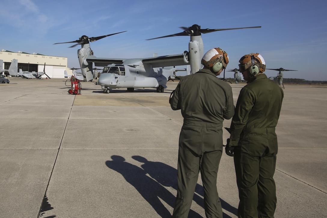 MARINE CORPS AIR STATION NEW RIVER, N.C.—Lance Cpl. Luke Peters and his fellow Marine discuss an MV-22B Block C Osprey after it landed aboard MCAS New River, N.C., Feb. 1, 2017. This is the first time the training squadron has received a brand-new, straight from the factory aircraft. The MV-22B Block C incorporates weather radar; an improved environmental control system; troop commander situational awareness display; upgraded standby flight instrument and GPS; and additional chaff/flare equipment.  Block C development first began in 2006. Peters is a crew chief with Marine Medium Tiltrotor Training Squadron 204 . (U.S. Marine Corps photo by Lance Cpl. Miranda Faughn/Released)