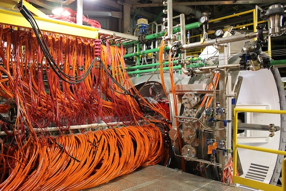 The facility modifications necessary to install the segmented heater in the H2 Arc Heater were designed by AEDC engineers in 2015, and fabrication was accomplished in 2016. Checkout of H2 began in fall of 2016, with the first Key Performance Parameter test condition demonstrated successfully in December. Two more KPP conditions were demonstrated before the end of the year and four of the remaining six were demonstrated in January 2017. Pictured is the segmented heater and H2 Arc Heater test cell. (AEDC photo