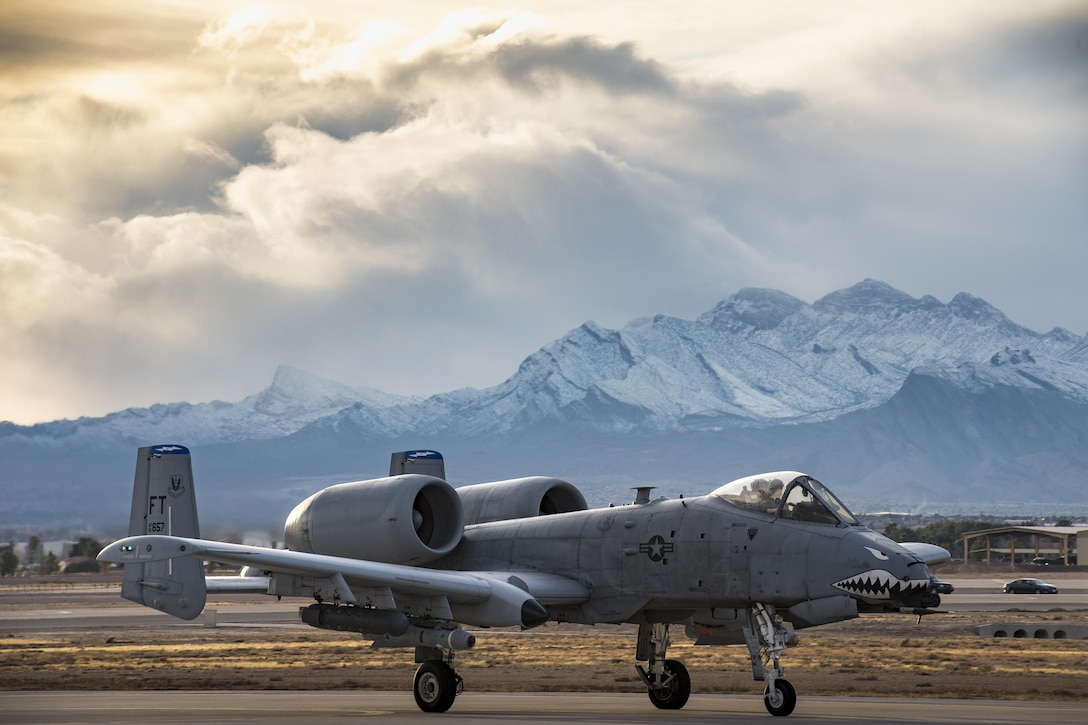An A-10C Thunderbolt II from the 74th Fighter Squadron taxis down the runway during Green Flag-West 17-03 Jan. 23, 2017, at Nellis Air Force Base, Nev. The 74th FS brought 12 A-10s to GFW in support of a joint, large-force, combat-readiness exercise for close air support integration training. (U.S. Air Force photo/Staff Sgt. Ryan Callaghan)