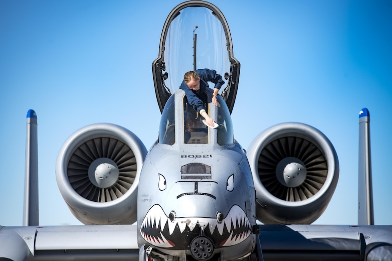 Senior Airman Felicia Anderson, 74th Aircraft Maintenance Unit crew chief, cleans cockpit glass on an A-10C Thunderbolt II during Green Flag-West 17-03, Jan. 25, 2017, at Nellis Air Force Base, Nev. GFW is an air-land integration combat training exercise, which hosted 12 A-10s from Moody Air Force Base, Ga. Accompanying the aircraft were 130 maintenance personnel who worked around the clock to launch 18 sorties per day. (U.S. Air Force photo by Staff Sgt. Ryan Callaghan)