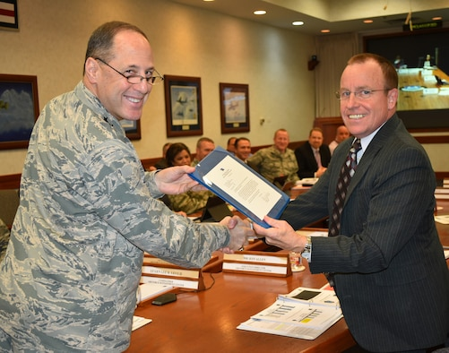 Lt. Gen. Lee K. Levy II, Air Force Sustainment Center commander, presents Jeffrey Allen, AFSC executive director, with a letter from Gen. Ellen Pawlikowski, Air Force Materiel Command commander, congratulating him on being a recipient of the 2016 Presidential Rank Award of Meritorious Executive. The award will be presented by the President of the United States in a formal ceremony later this year. (Air Force photo by Darren D. Heusel)
