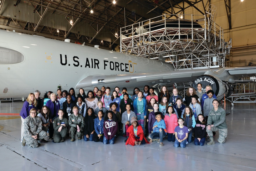 """Forty 6th, 7th and 8th grade students, along with their mentors pose for a group photo following their tour of an E-3 Sentry aircraft. The students attended the first STEM Girls Camp, """"STEM Like a Girl"""" held at the base Jan. 28. (Air Force photo by Kelly White)"""