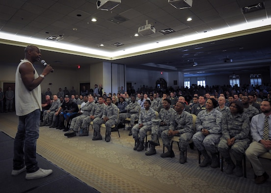 Actor/comedian Dave Chappelle tells a few jokes and thanks military members at the Charleston Club at Joint Base Charleston, S.C. Feb. 2  Chappelle was in town for his stand-up comedy show when he made the visit to see service members and federal civilians at the base. (U.S. Air Force photo by Senior Airman Tom Brading)