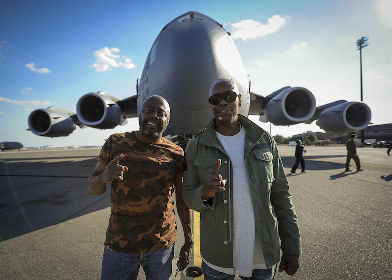(from right) Actor/comedians Dave Chappelle and  Donnell Rawlings pose for a photo in front of a Joint Base Charleston C-17 Globemaster III Feb. 2.  Chappelle was in town for his stand-up comedy show when he made the visit to see service members and federal civilians at the base. (U.S. Air Force photo by Senior Airman Tom Brading)