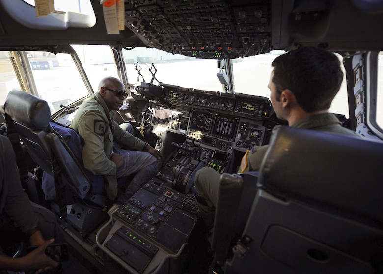 Actor/comedian Dave Chappelle chats with a 315th Airlift Wing pilot on the flight deck of a C-17 Globemaster III static display at Joint Base Charleston, S.C.  Chappelle was in town for his stand-up comedy show when he made the visit to see service members and federal civilians at the base Feb. 2. (U.S. Air Force photo by Senior Airman Tom Brading)