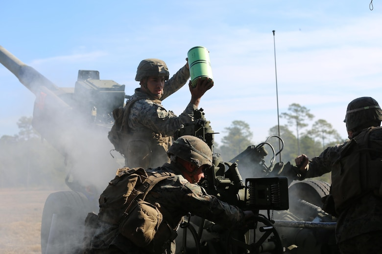 Marines execute a fire mission while utilizing a M777 howitzer during a training exercise at Camp Lejeune, N.C., Feb, 1, 2017. Through repetitions of firing the Marines improved their combat readiness, aiding the 2nd Marine Division and maximizing its effectiveness on the battlefield.  The Marines are artillerymen assigned to 2nd Battalion, 10th Marine Battery. (Marine Corps photo by Cpl. Shannon Kroening)