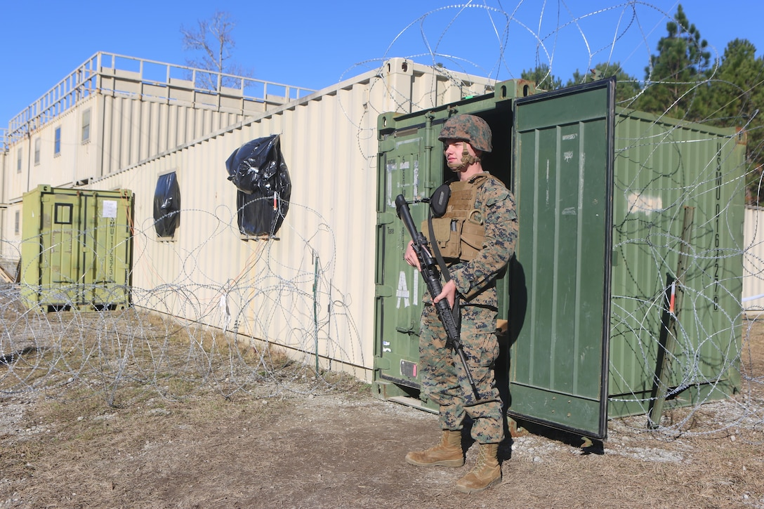 Lance Cpl. Bailey Hammanreichel stands guard in front the temporary special compartmentalized information facility at Camp Lejeune, N.C., Jan. 25, 2017. Marines with Alpha Co., 2nd Radio Battalion are participating in an embassy reinforcement exercise in order to prepare for a Special Purpose Marine Air-Ground Task Force. Hammanreichel is a ground electronics telecommunications and information technology systems maintainer with the company. (U.S. Marine Corps Photo by Cpl. Shannon Kroening)