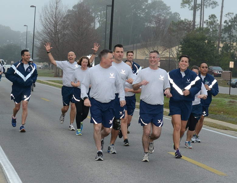 Lt. Gen. Brad Webb, commander of Air Force Special Operations Command, and Chief Master Sgt. Greg Smith, AFSOC command chief, run together during a 5K run at Hurlburt Field, Fla., Feb. 3, 2017. The AFSOC headquarters staff runs together once a month. (U.S. Air Force photo/Staff Sgt. Melanie Holochwost)