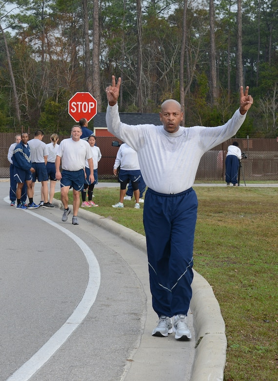 Chief Master Sgt. Kerry Henderson, Air Force Special Operations Command communications and information chief, celebrates after completing a 5K run at Hurlburt Field, Fla., Feb. 3, 2017. (U.S. Air Force photo/Staff Sgt. Melanie Holochwost)
