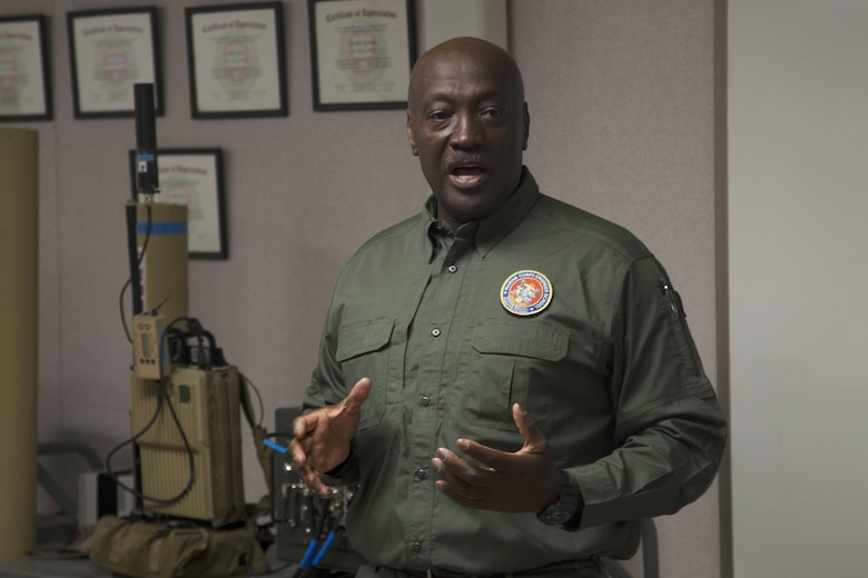 Melvin Harris, counter improvised explosive device (IED) instructor, Marine Corps Engineer School, teaches members of the Drug Enforcement Administration Citizens' Academy Alumni Association the basics on countering IEDs at Range 800 aboard Marine Corps Air Ground Combat Center, Twentynine Palms, Calif., Jan. 26, 2017. (U.S. Marine Corps photo by Cpl. Connor Hancock)