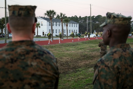 Colonel Jeffrey C. Smitherman, commanding officer of 6th Marine Corps District (6th MCD), left, and Sgt. Maj. Anthony N. Page, sergeant major of 6th MCD, observes an Initial Strength Test (IST) during the 8412 Slating Conference aboard Marine Corps Recruit Depot Parris Island, South Carolina, Feb. 3, 2017. The Slating Conference brings the recruiting command together to discuss the movement of their Marines across recruiting stations. A Marine holding the military occupational specialty of 8412 is known as a career recruiter. These recruiters use the IST to assist them in the training and mentoring of future Marines.  (U.S. Marine Corps photo by Lance Cpl. Jack A. E. Rigsby/Released)