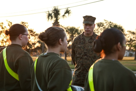 Master Sergeant Paul E. Davis Jr., recruiter instructor of Recruiting Station Jacksonville, 6th Marine Corps District, speaks to recruits after an Initial Strength Test (IST) during the 8412 Slating Conference aboard Marine Corps Recruit Depot Parris Island, South Carolina, Feb. 3, 2017. The Slating Conference brings the recruiting command together to discuss the movement of their Marines across recruiting stations. A Marine holding the military occupational specialty of 8412 is known as a career recruiter. These recruiters use the IST to assist them in the training and mentoring of future Marines. (U.S. Marine Corps photo by Lance Cpl. Jack A. E. Rigsby/Released)