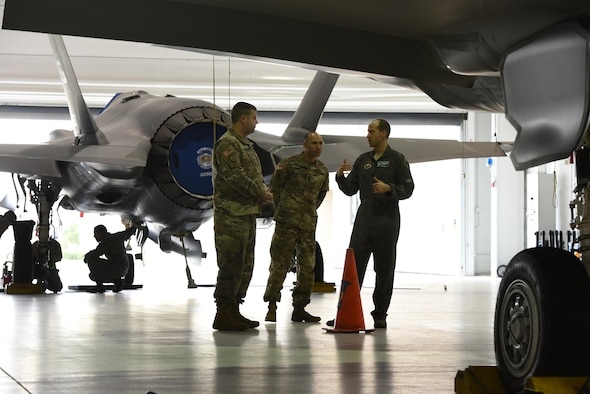 U.S. Air Force Lt. Col. Scott Gunn, 33rd Operations Support Squadron commander, right, discusses the weapons bay of an F-35A Lightning II with COL Samuel Saine, 4th Battlefield Coordination Detachment commander, left, and Sgt. Maj. Miguel Quiros, 4 BCD sergeant major, center, Jan. 26, 2017, at Eglin Air Force Base, Florida. Saine and Qurios visited the 33rd Fighter Wing while conducting a battlefield circulation analysis to engage with and evaluate Ground Liaison Officers embedded in the unit. (U.S. Air Force photo by Staff Sgt. Peter Thompson)