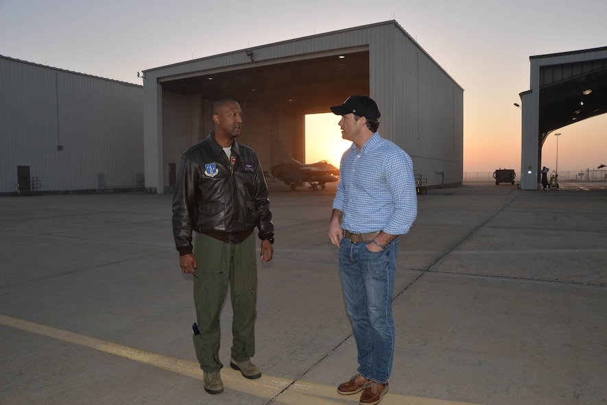 Lt. Col. Ernie Mayfield, Director of Operations, 138th Fighter Wing, Det. 1, talks with Peter Hegseth, Fox & Friends television news contributor, as day breaks during the morning of Hegseth's aerospace defense familiarization flight. Hegseth flew with the unit as part of a Continental Aerospace Defense Region communications outreach plan to help enhance public knowledge about temporary flight restrictions during high-profile events such as Super Bowl LI. (Photo released by Mary McHale)