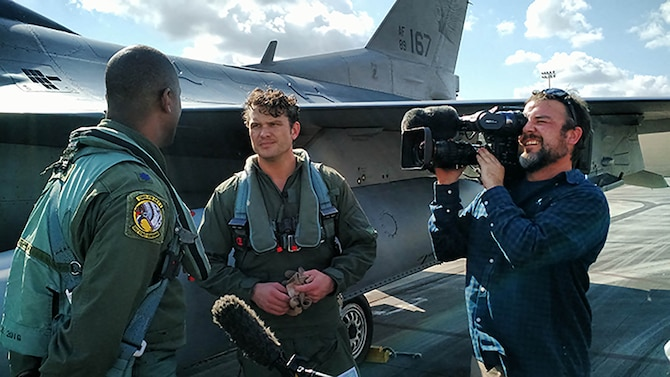 Lt. Col. Ernie Mayfield, Director of Operations, 138th Fighter Wing, Det. 1, talks with Peter Hegseth, Fox & Friends television news, following his aerospace defense familiarization flight Feb. 1. at Ellington Field Joint Reserve Base, Houston Texas. Hegseth flew with the unit as part of a Continental Aersospace Defense Region communications outreach plan to help enhance public knowledge about temporary flight restrictions during high-profile events such as Super Bowl LI. (Photo released by Mary McHale)