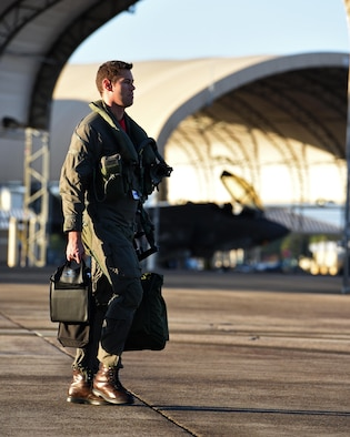 U.S. Navy Lt. Cmdr. Charles Escher, Strike Fighter Squadron (VFA-101) operations officer, walks across the flightline before flying and Air force F-35A Dec. 6, 2016, at Eglin Air Force Base, Florida. For only the second time at Eglin AFB, a Naval Aviator has been selected to dual qualify in the U.S. Navy's F-35C and the Air Force's F-35A. Escher plans to use what he learns from his experience with the 33 FW to help the F-35 enterprise grow. He looks to join a group of test pilots at Edwards AFB, California, where he will have the opportunity to be the Navy's voice for the aircraft weapons and vehicle system development. (U.S. Air Force photo/ Staff Sgt. Peter Thompson)