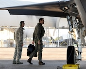 U.S. Navy Lt. Cmdr. Charles Escher, Strike Fighter Squadron (VFA-101) operations officer, completes a walk-around prior to flying an Air Force F-35A Dec. 6, 2016, at Eglin Air Force Base, Florida. For only the second time at Eglin AFB, a Naval Aviator has been selected to dual qualify in the U.S. Navy's F-35C and the Air Force's F-35A. Escher plans to use what he learns from his experience with the 33 FW to help the F-35 enterprise grow. He looks to join a group of test pilots at Edwards AFB, California, where he will have the opportunity to be the Navy's voice for the aircraft weapons and vehicle system development. (U.S. Air Force photo/ Staff Sgt. Peter Thompson)