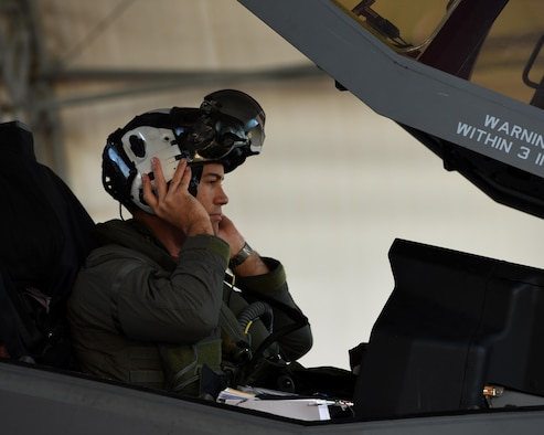 U.S. Navy Lt. Cmdr. Charles Escher, Strike Fighter Squadron (VFA-101) operations officer, dawns his helmet prior to flying an Air Force F-35A Dec. 6, 2016, at Eglin Air Force Base, Florida. For only the second time at Eglin AFB, a Naval Aviator has been selected to dual qualify in the U.S. Navy's F-35C and the Air Force's F-35A. Escher plans to use what he learns from his experience with the 33 FW to help the F-35 enterprise grow. He looks to join a group of test pilots at Edwards AFB, California, where he will have the opportunity to be the Navy's voice for the aircraft weapons and vehicle system development. (U.S. Air Force photo/ Staff Sgt. Peter Thompson)
