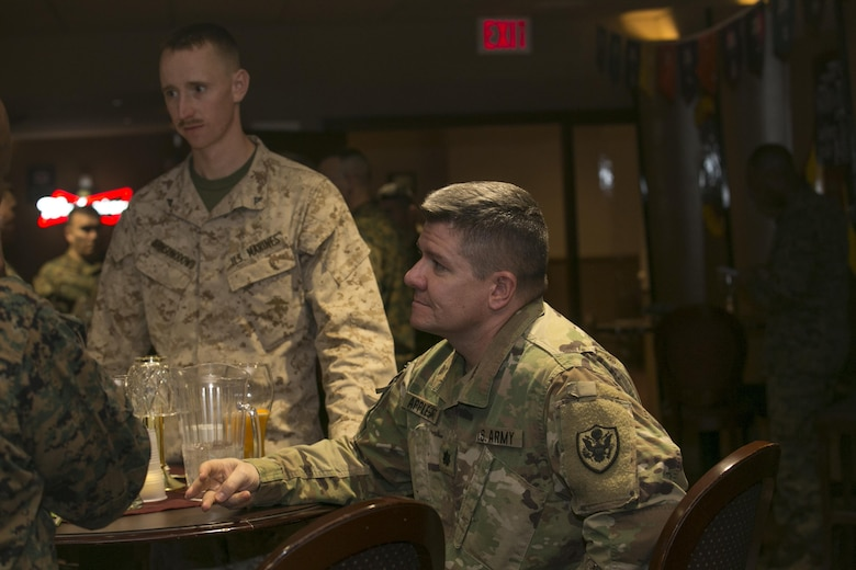 Army Lt. Col. Scott Applegate, deputy branch chief, Cyber Policy Branch, Strategic Plans and Policies, talks with Marine Corps Communication-Electronics School leadership at Frontline Restaurant aboard Marine Corps Air Ground Combat Center, Twentynine Palms, Calif., Jan. 30, 2017. (Marine Corps photo by Cpl. Thomas Mudd)