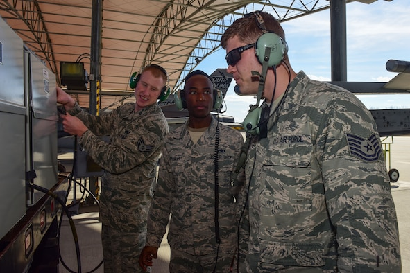U.S. Air Force Tech. Sgt. Chance Watson, an avionics technician assinged to the 169th Aircraft Maintenance Squadron speaks to Combat Shield team personnel at McEntire Joint National Guard Base, S.C., Jan. 18, 2017. The South Carolina Air National Guard's 169th Aircraft Maintenance Squadron's F-16 Avionics shop received its annual Combat Shield evaluation. Combat Shield evaluates the reliability of the jet's radar threat warning system, electronic countermeasure, and high-speed anti-radiation missile targeting system pods. Each component is crucial to the success of the F-16 fighter pilot in combat situations.  (U.S. Air National Guard photo by Airman 1st Class Megan Floyd)