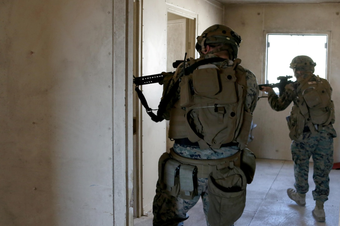 """Marines clear a building during Military Operations in Urban Terrain training aboard Marine Corps Outlying Field Atlantic, N.C., Feb. 2, 2017. Nearly 40 Marines with supporting personnel participated in the weeklong training that simulated hostile takeovers and how to overcome unexpected situations with small unit leadership. """"My end goal is to ensure any of my Marines are able to take my place if the situation arises,"""" said Cpl. Christian Leishman, a squad leader for the exercise. The Marines are assigned to Marine Wing Support Squadron 271, Marine Aircraft Group 14, 2nd Marine Aircraft Wing. (U.S. Marine Corps photo by Cpl. Jason Jimenez/ Released)"""