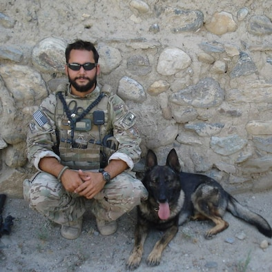 U.S. Air Force Staff Sgt. David Macdonald, dog handler, poses for a photo with military working dog Ali at Bagram Air Base, Afghanistan, in 2013. (Courtesy photo)