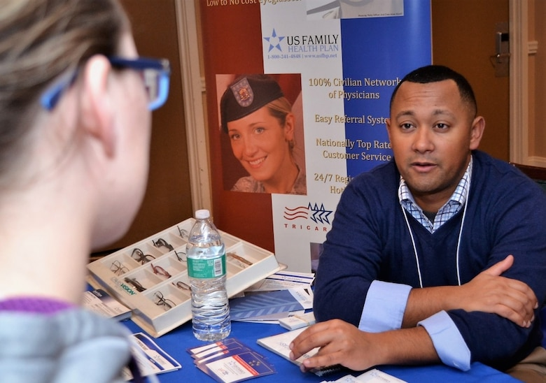 Wil Acosta, A former Marine who now represents US Family Health Plan, assists a 111th Attack Wing member during a pre-deployment Yellow Ribbon Reintegration Program event held in Carbon County, Pa. Jan. 7, 2017. Information booths were set up to assist program attendees in becoming aware of the resources available to them and their dependents. (U.S. Air National Guard photo by Tech. Sgt. Andria Allmond)