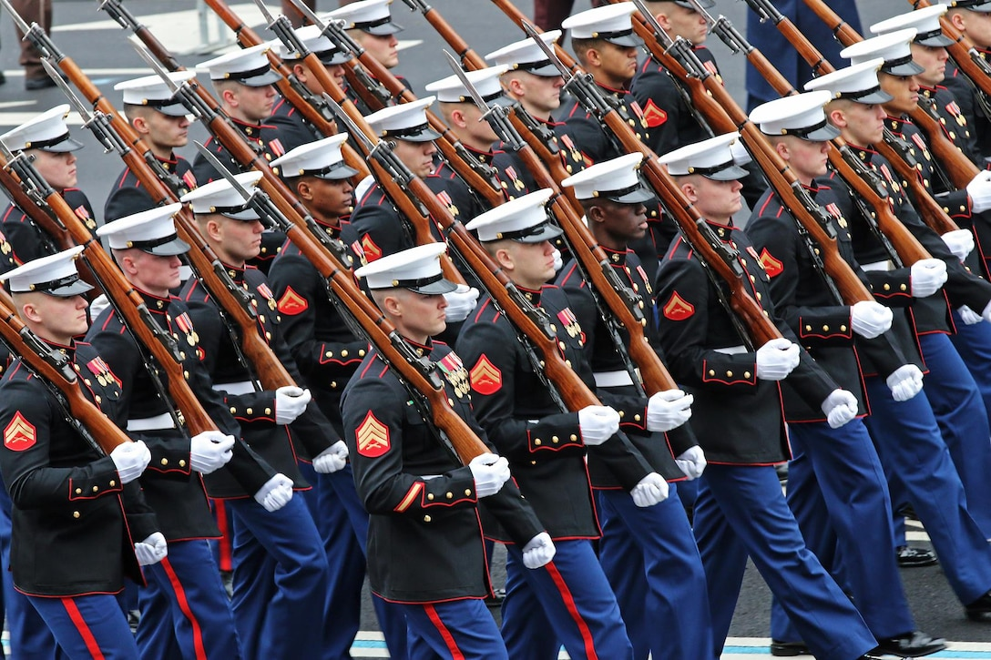 Marines of the U.S. Marine Corps Honor Guard march down Pennsylvania Avenue during the 58th Presidential Inauguration in Washington, D.C., Jan. 20, 2017. Military personnel assigned to Joint Task Force - National Capital Region provided military ceremonial support and Defense Support of Civil Authorities during the inaugural period. (DoD photos by U.S. Army Sgt. Paige Behringer)