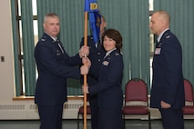 Col. Jeffrey Hedges (right), outgoing 109th Mission Support Group commander, looks on during  the MSG change of command ceremony. 109th Airlift Wing commander Col. Shawn Clotheir hands the guidon to the incoming MSG commander Col. Maureen Murphy during this time honored military tradition signifying the transfer of responsiblity. The ceremony took place at Stratton Air National Guard Base, New York, on Feb. 4, 2017. (U.S. Air National Guard photo by Staff Sgt. Ben German/Released)