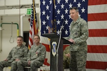 """Col. Thomas """"Britt"""" Hatley addresses the 119th Wing unit members standing in formation for the first time as their commander during a change of command ceremony at the North Dakota Air National Guard Base, Fargo, N.D., Feb. 4, 2017. Hatley is replacing out-going 119th Wing commander Col. Kent Olson, seated second from left, who has been the 119th Wing commander since March 14, 2013. (U.S. Air National Guard photo by Senior Master Sgt. David H. Lipp/Released)"""
