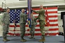 "Maj. Gen. Al Dohrmann, the North Dakota adjutant general, right, presents the 119th Wing unit flag to Col. Thomas ""Britt"" Hatley in a symbolic gesture with the flag representing the organizational command of the 119th Wing at the North Dakota Air National Guard Base, Fargo, N.D., Feb. 4, 2017. (U.S. Air National Guard photo by Senior Master Sgt. David H. Lipp/Released)"
