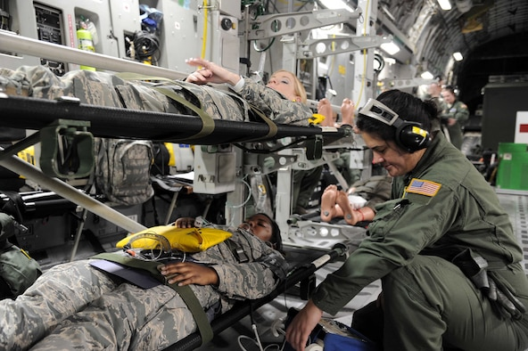 Master Sgt. Darlena Martens 446th Aeromedical Evacuation Squadron medical technician observes a patient's vital signs during an aeromedical evacuation exercise Feb. 2, 2017 at Dobbins Air Reserve Base, Ga. This training opportunity provided Airmen a chance to work with members from other bases and strengthen partnerships. (U.S. Air Force Photo by Tech Sgt. Peter Dean)