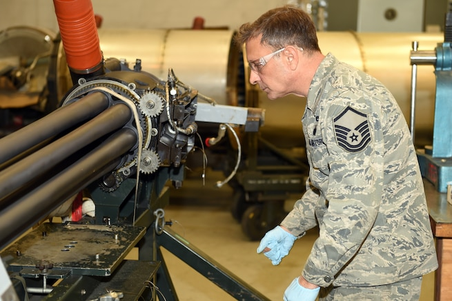 170204-Z-EZ686-023 -- Master Sgt. Thomas Barjaktarovich of the 127th Maintenance Group inspects the 30mm GAU-8 Avenger Gatling gun from an A-10 Thunderbolt II of the 107th Fighter Squadron, at Selfridge Air National Guard Base, Mich., Feb. 5, 2017.  The GAU-8 Avenger requires an in depth inspection every 36 months.  (U.S. Air National Guard photo by MSgt. David Kujawa)