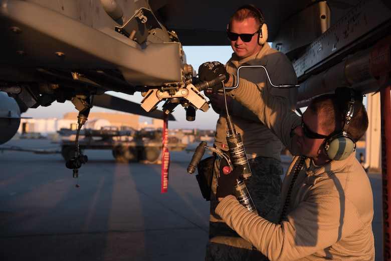 Master Sgt. Steve Frasier and Tech. Sgt. Joseph Benoit, 407th Expeditionary Maintenance Squadron weapons specialists, test the functionality of weapons rack releasing system of an F-16 Fighting Falcon at the 407th Air Expeditionary Group Feb. 4, 2017. The 407th Air Expeditionary Group is supporting Operation Inherent Resolve in the fight against the Islamic State of Iraq and the Levant.  (U.S. Air Force photo/Master Sgt. Benjamin Wilson)(Released)