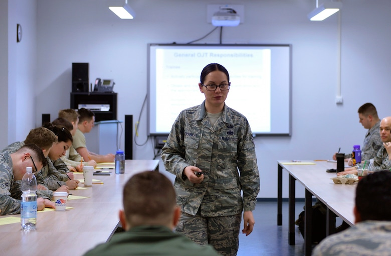 Tech. Sgt. Christine Berrios, 721st Aerial Port Squadron unit training manager, conducts an Air Force Training Course on Ramstein Air Base, Germany, Jan. 27, 2017. UTMs are responsible for managing the training program of their unit. (U.S. Air Force photo by Airman 1st Class Joshua Magbanua)