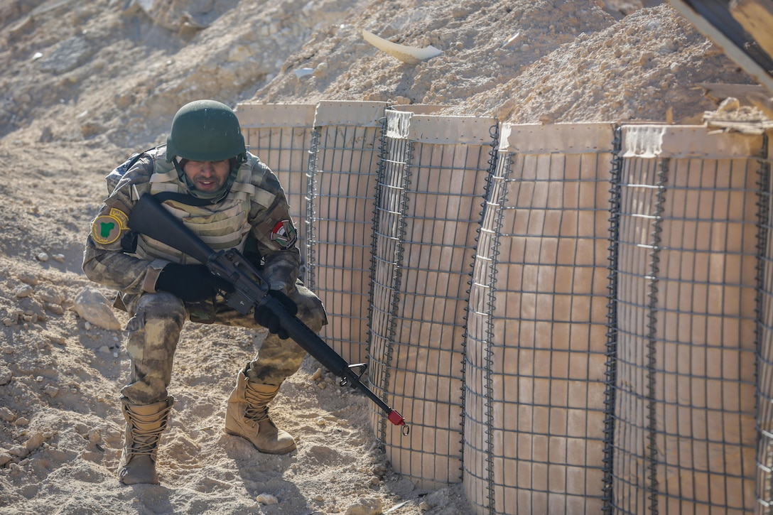 An Iraqi security forces soldier seeks cover during react to contact training at Al Asad Air Base, Iraq, Feb. 1, 2017. Training at building partner capacity sites is an integral part of Combined Joint Task Force – Operation Inherent Resolve's effort to train ISF personnel.  CJTF-OIR is the global Coalition to defeat ISIL in Iraq and Syria.  (U.S. Army photo by Sgt. Lisa Soy)