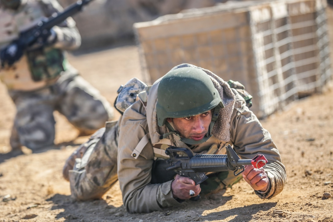 An Iraqi security forces soldier crawls to his objective during react to contact training at Al Asad Air Base, Iraq, Feb. 1, 2017. Training at building partner capacity sites is an integral part of Combined Joint Task Force – Operation Inherent Resolve's effort to train ISF personnel.  CJTF-OIR is the global Coalition to defeat ISIL in Iraq and Syria.  (U.S. Army photo by Sgt. Lisa Soy)