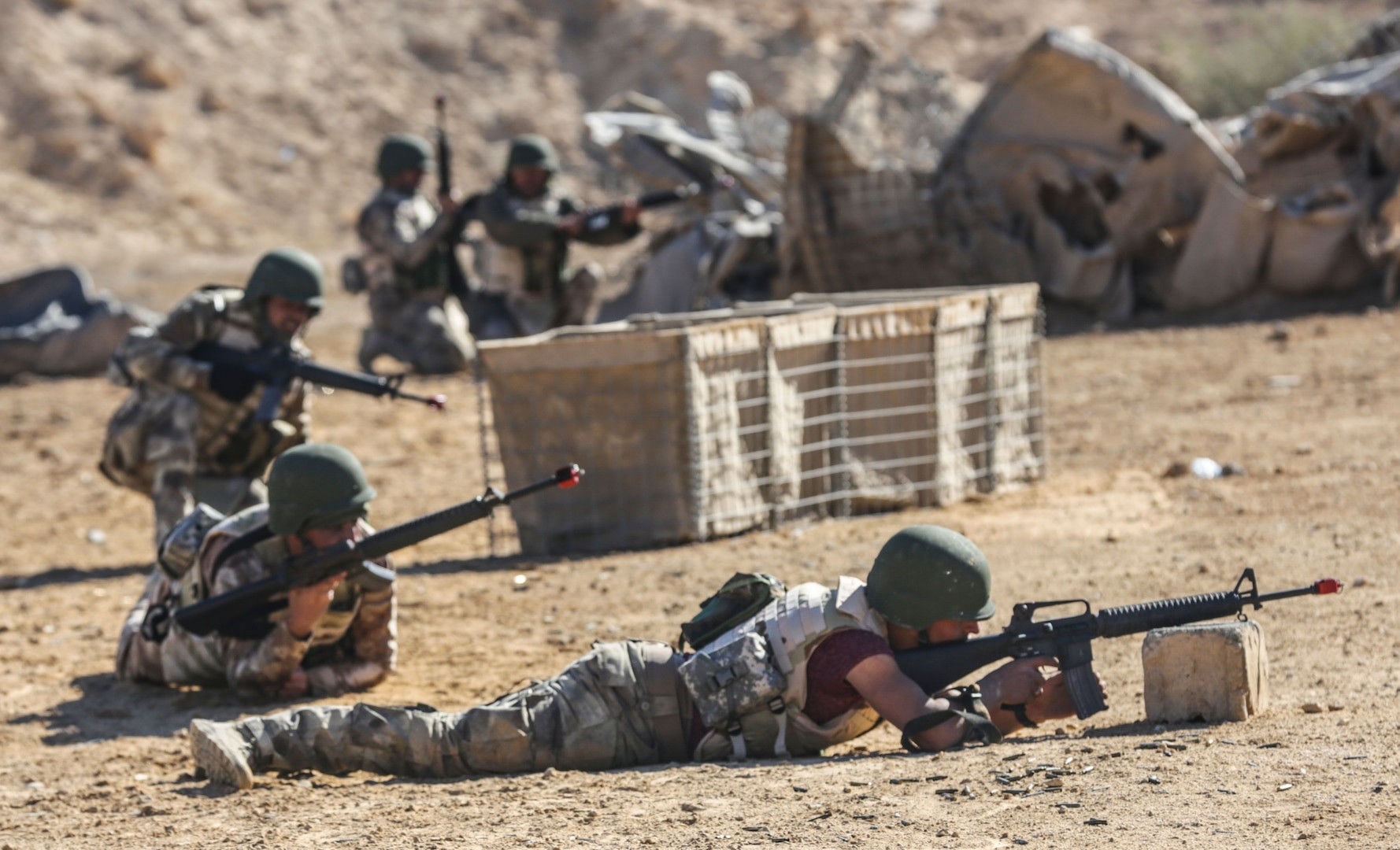 Iraqi security forces soldiers practice react to contact movements during training at Al Asad Air Base, Iraq, Feb. 1, 2017. Training at building partner capacity sites is an integral part of Combined Joint Task Force – Operation Inherent Resolve's effort to train ISF personnel.  CJTF-OIR is the global Coalition to defeat ISIL in Iraq and Syria.  (U.S. Army photo by Sgt. Lisa Soy)
