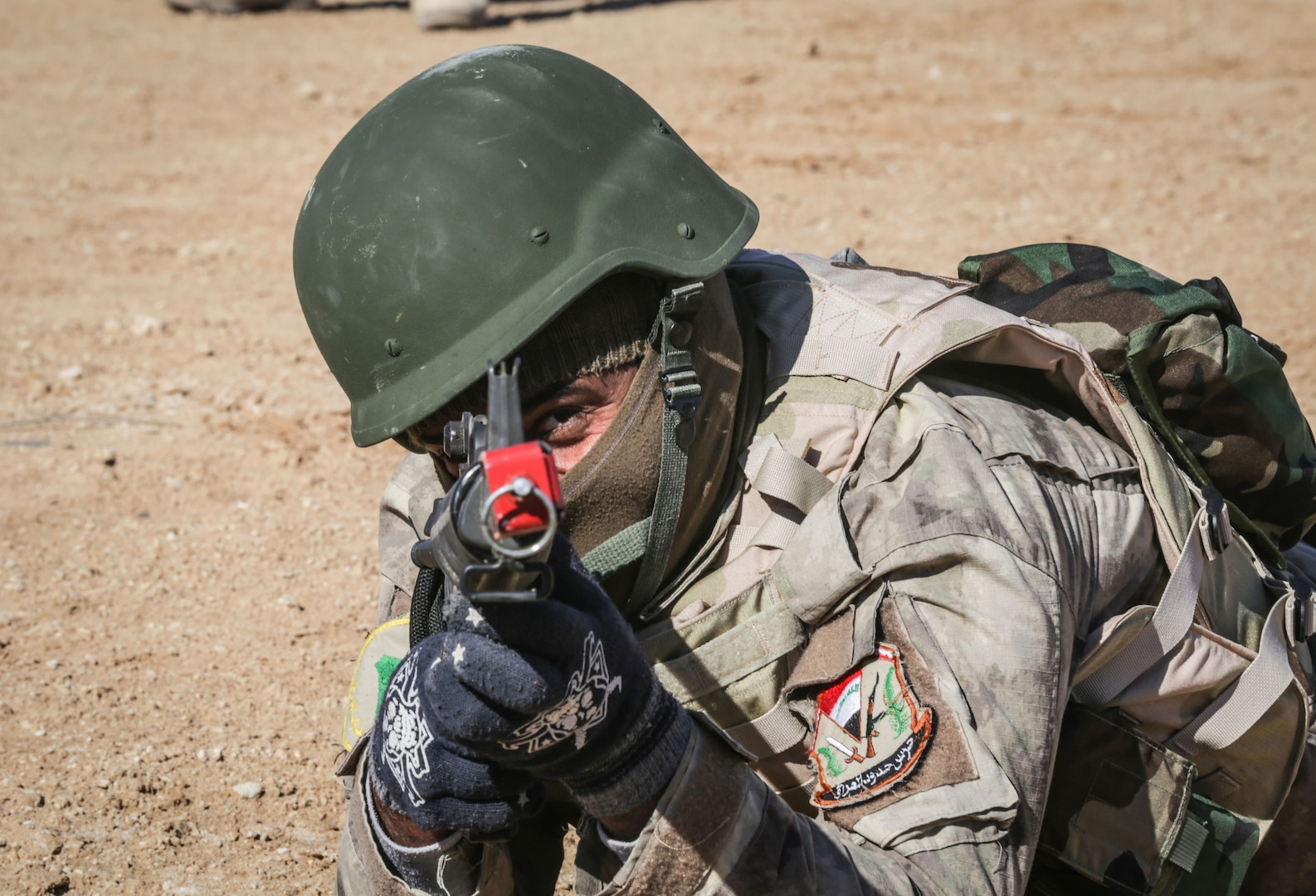 An Iraqi security forces soldier aims his M16 rifle at a target during react to contact training at Al Asad Air Base, Iraq, Feb. 1, 2017. Training at building partner capacity sites is an integral part of Combined Joint Task Force – Operation Inherent Resolve's effort to train ISF personnel.  CJTF-OIR is the global Coalition to defeat ISIL in Iraq and Syria.  (U.S. Army photo by Sgt. Lisa Soy)