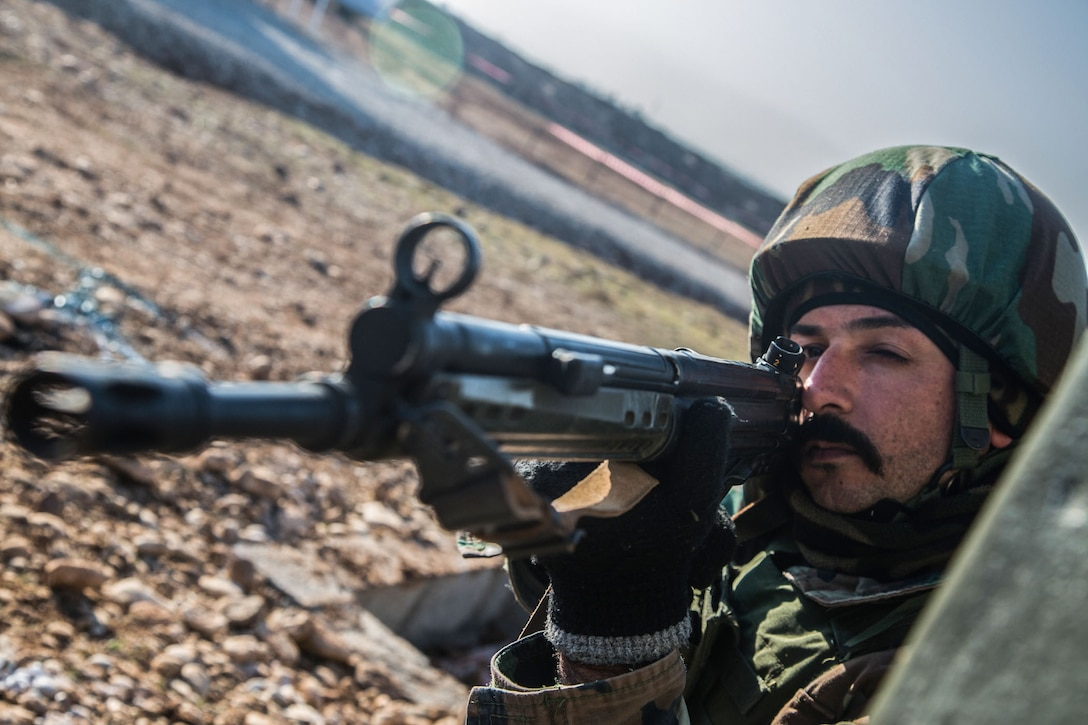 A Peshmerga soldier provides security during building assault training at Bnaslawa, Iraq, Feb. 2, 2017. This training is critical to enabling local security forces to counter ISIL as they continue to liberate their homeland. Combined Joint Task Force - Operation Inherent Resolve is the global Coalition to defeat ISIL in Iraq and Syria. (U.S. Army photo by Spc. Ian Ryan)