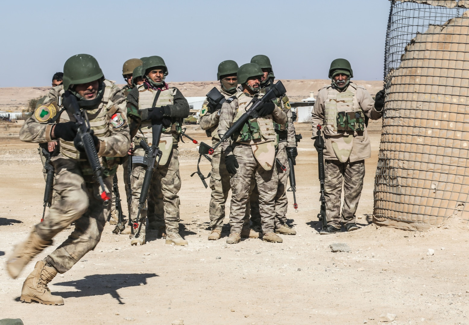 Iraqi security forces soldiers conduct react to contact training at Al Asad Air Base, Iraq, Feb. 1, 2017. Training at building partner capacity sites is an integral part of Combined Joint Task Force – Operation Inherent Resolve's effort to train ISF personnel.  CJTF-OIR is the global Coalition to defeat ISIL in Iraq and Syria.  (U.S. Army photo by Sgt. Lisa Soy)