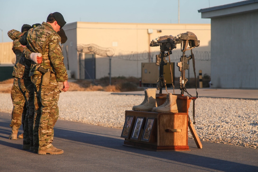 Soldiers of Special Forces Operational Detachment - Alpha 0224, 10th Special Forces Group (Airborne) memorialize two of their fallen brothers during a memorial held at Kunduz Airfield in Afghanistan on Nov. 7, 2016. Maj. Andrew Byers, the commander for ODA 0224, and Sgt. 1st Class Ryan Gloyer, an intelligence sergeant with ODA 0224, were killed in action during the Battle of Boz Qandahari, Afghanistan, on Nov. 2-3, 2016. (U.S. Army photo by Sgt. Connor Mendez/Reviewed)