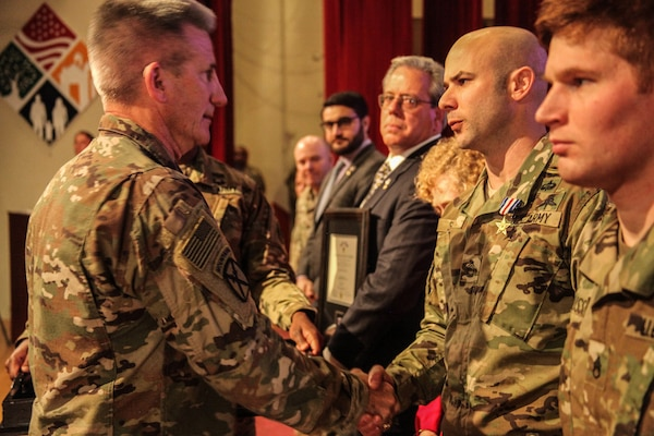 Gen. John Nicholson, commander of the Resolute Support mission and U.S. Forces-Afghanistan (Left), congratulates Sgt. 1st Class Brian Seidl, 10th Special Forces Group (Airborne), after presenting him with the Silver Star award on Fort Carson, Colo., Feb 1, 2017. Seidl earned the Silver Star for his heroic actions during the Battle of Boz Qandahari, Afghanistan on Nov. 2-3, 2016. (U.S. Army photo by Sgt. Connor Mendez/Reviewed)