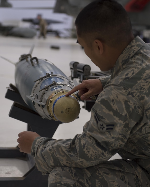 Airman 1st Class Daniel, an MQ-9 Reaper weapons load crew member, inspects an inert munition before loading it onto an MQ-9 during a quarterly load crew competition at Holloman Air Force Base, N.M., Jan. 20, 2016. The weapons load crews for the German Air Force Tornado, F-16 Fighting Falcon and MQ-9 Reaper competed against each other to load weapons the most efficiently and with the least amount of procedural errors. Points for the competition are awarded based on weapons loading, tool kit inspection and uniform inspection categories. (U.S. Air Force photo by Senior Airman Chase Cannon/ Released)