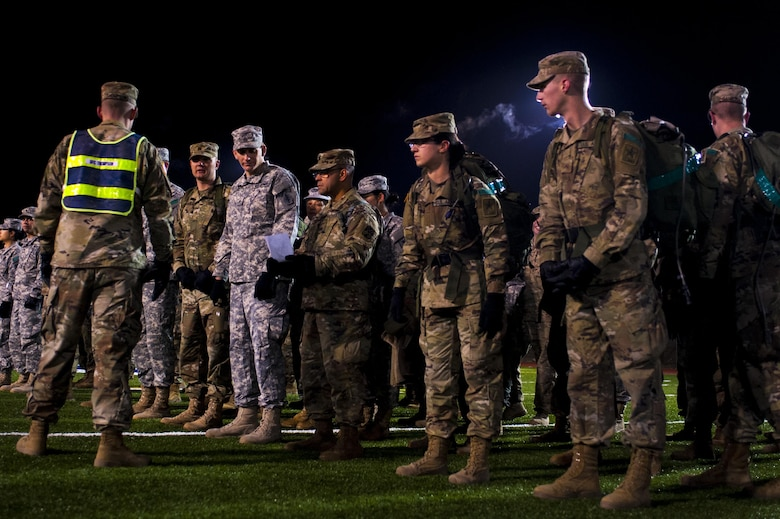 Soldiers of the 344th Military Intelligence Battalion receive a briefing while in formation before the beginning of the Fourth Annual Spartan Race at the Mathis Fitness Center football field on Goodfellow Air Force Base, Texas, February 3, 2017. The Spartan Race is a circuit, containing a 1.8-mile ruck march, a log carry around the track for 1 mile, body carries, 100 pullups, and a Humvee drag. (U.S. Air Force photo by Senior Airman Scott Jackson/Released)