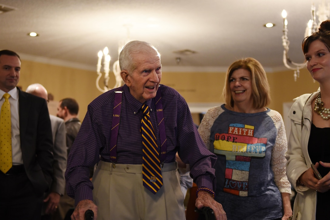 Raymond Odom, 93-year-old World War II veteran, greets friends and family during an event held at Arbor Rose Assisted Living Facility in Farmerville, La., Feb. 2, 2017. Odom served in the 8th Air Force during WWII and lost sight of his dog tags before heading back to the U.S. after the war was over. In May 2016, his dog tags were discovered in England, and sent to Louisiana where they were presented to him by the 8th Air Force commander, U.S. Air Force Maj. Gen. Thomas Bussiere. (U.S. Air Force photo by Senior Airman Erin Trower)