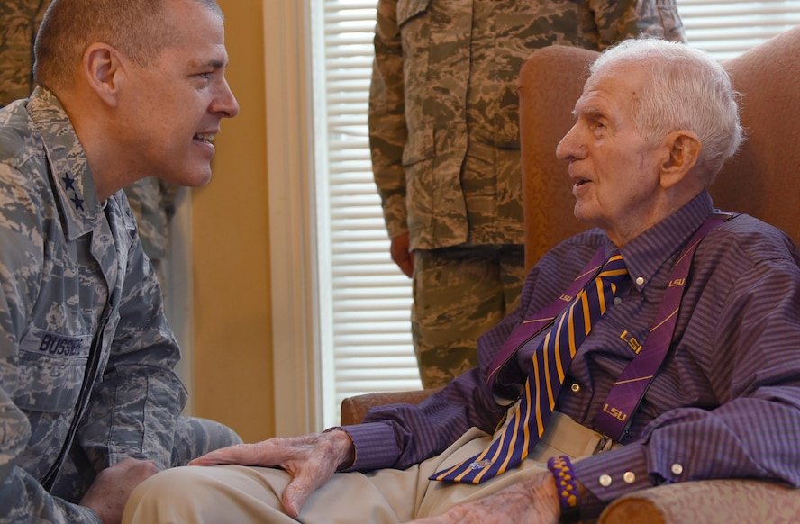 U.S. Air Force Maj. Gen. Thomas Bussiere, 8th Air Force commander, speaks with 93-year-old World War II veteran Raymond Odom during Odom's dog tag presentation at Arbor Rose Assisted Living Facility in Farmerville, La., Feb. 2, 2017. Odom was reunited with his lost dog tags during the 8th Air Force 75th Anniversary event after more than 70 years.  (U.S. Air Force photo by Senior Airman Erin Trower)